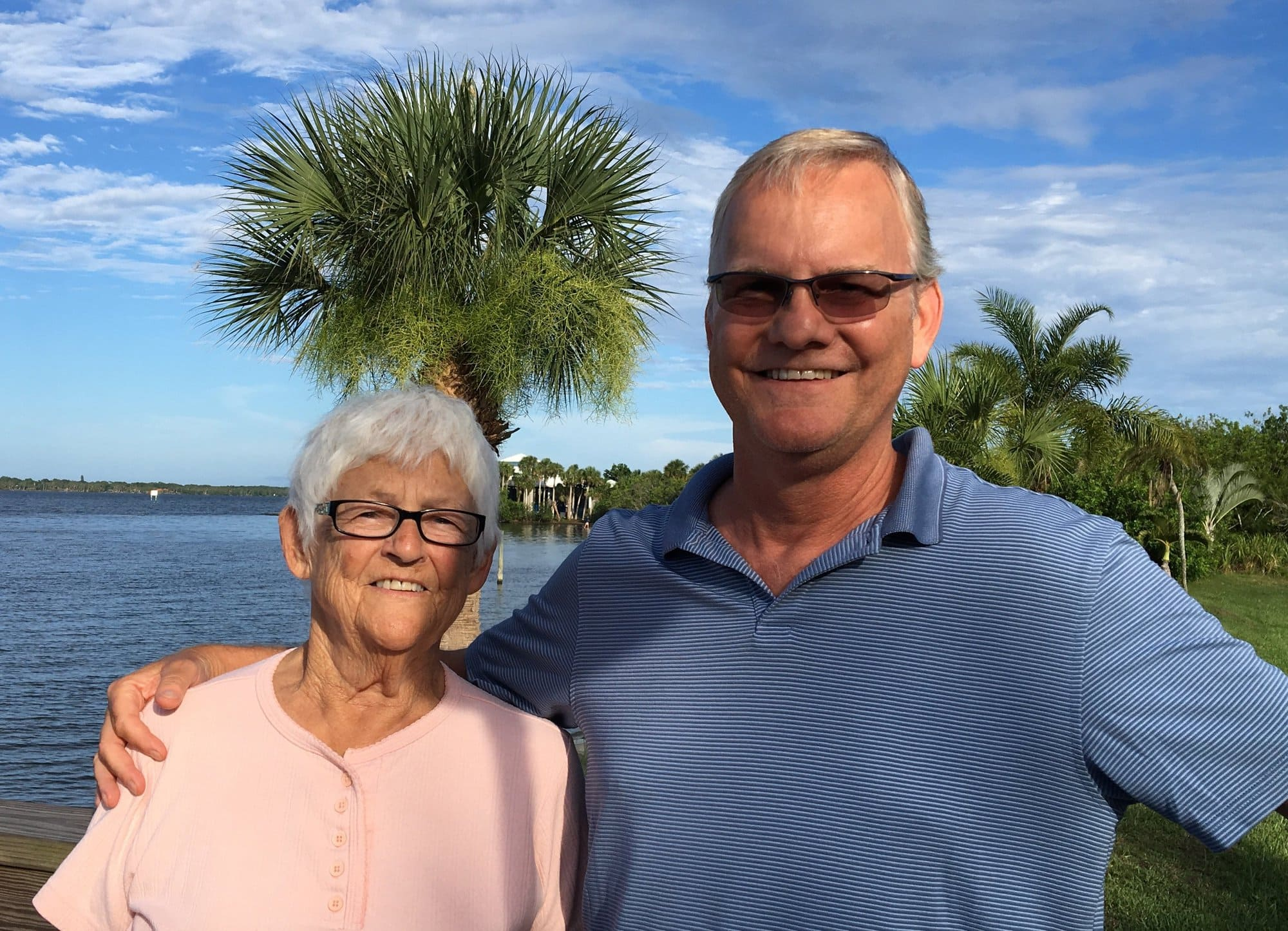 Norm and Mom on the waterfront, palm trees behind