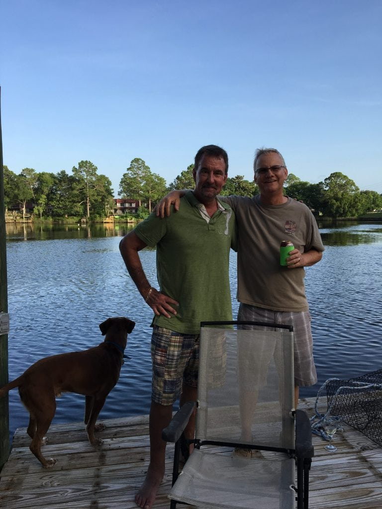 Norm and old friend Kirby standing on the dock