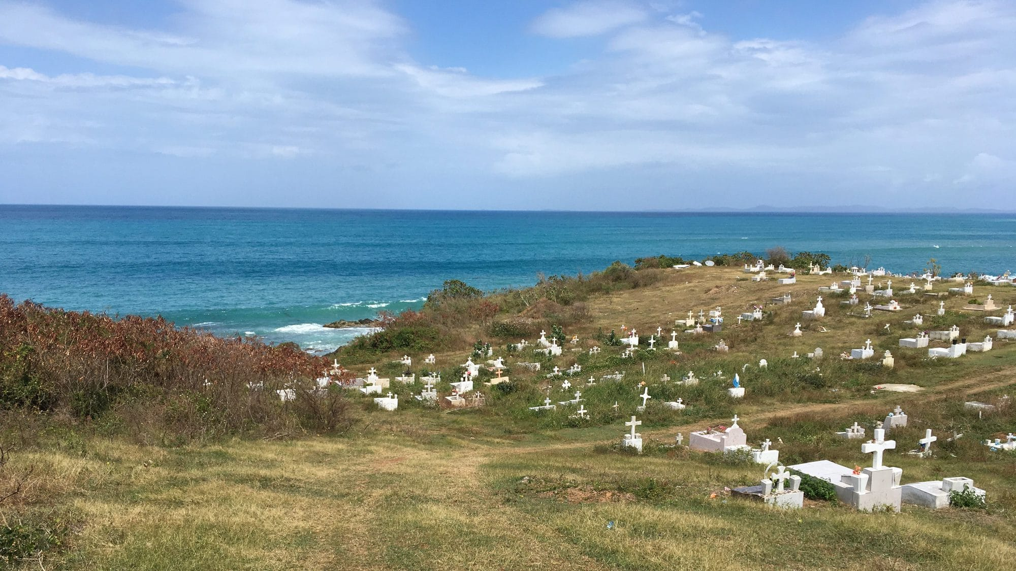 View of the ocean from across the hills of the cemetery