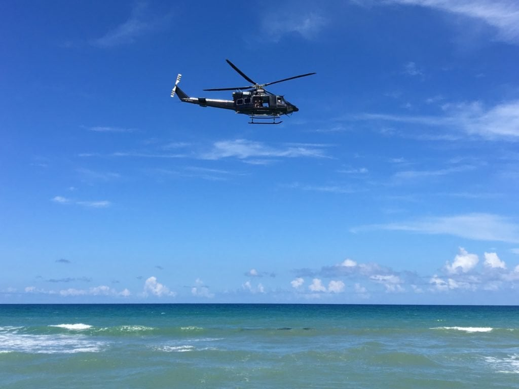 Helicopter flying low over the beach
