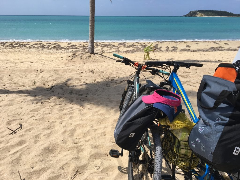 Two bikes parked at a beautiful beach