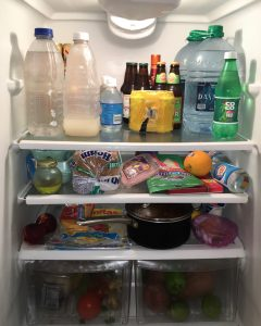 Refrigerator full of food, drinks, and leftovers