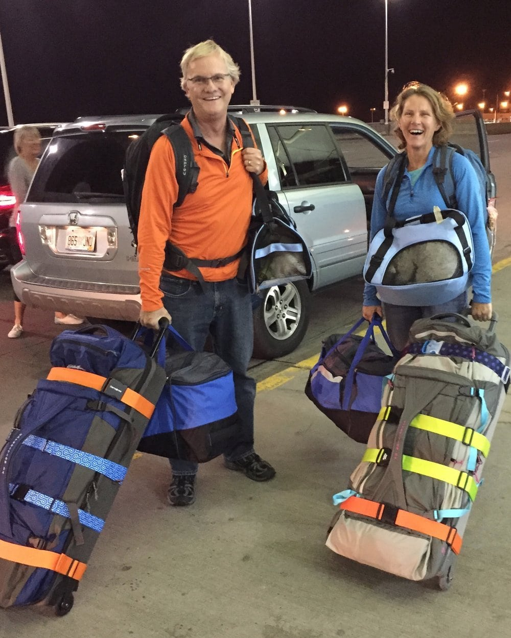 Norm and Deb with 3 bags and 1 dog each