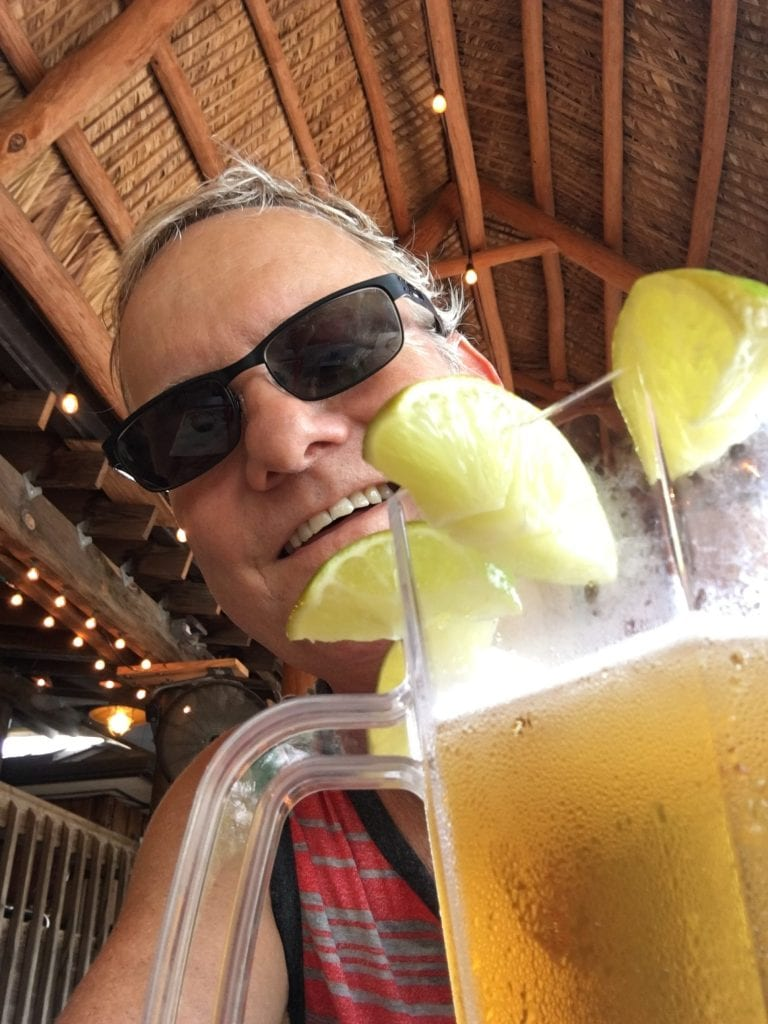 Norm and a pitcher of beer with limes all around the rim