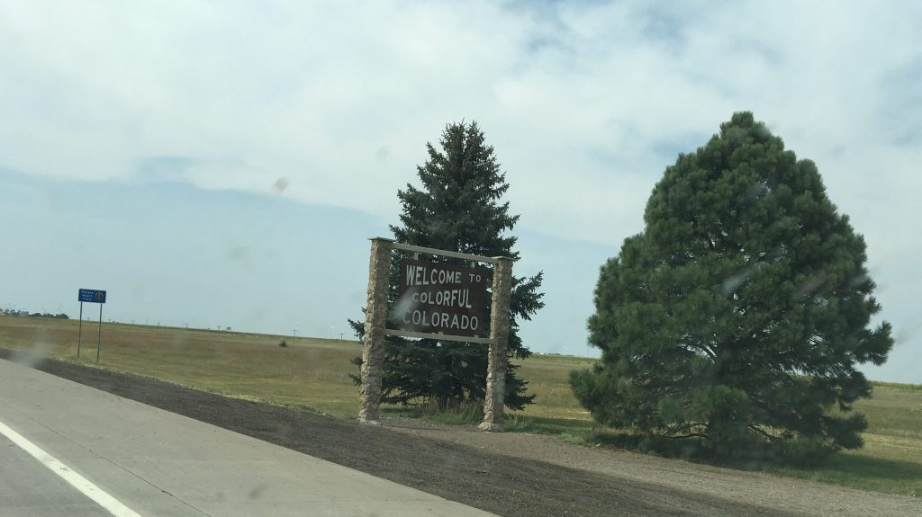 Welcome to Colorado sign at the state line from Kansas.