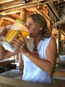 Deb drinking from a pitcher of beer
