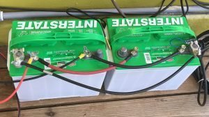 Two marine batteries cabled together