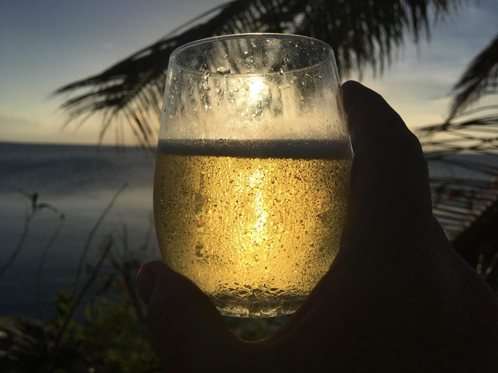 A toast with Champagne in the setting sun