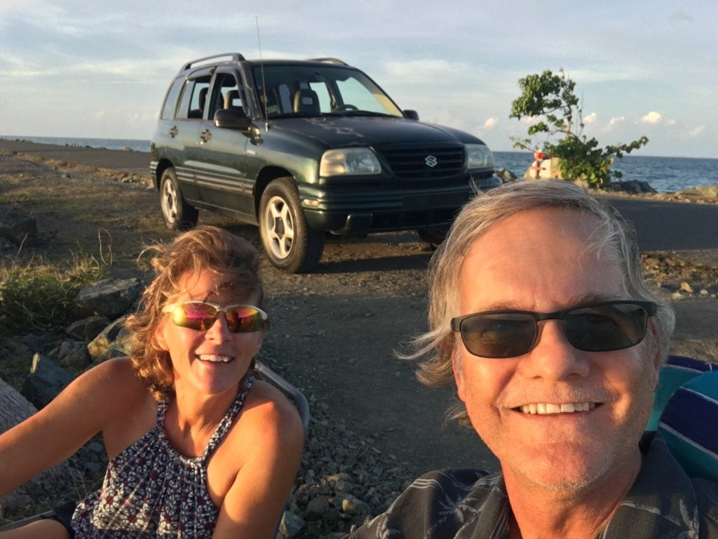 Norm and Deb, car in background