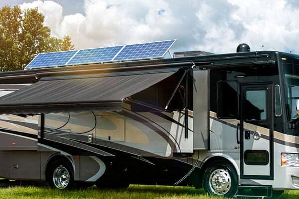 RV with 3 solar panels on the roof
