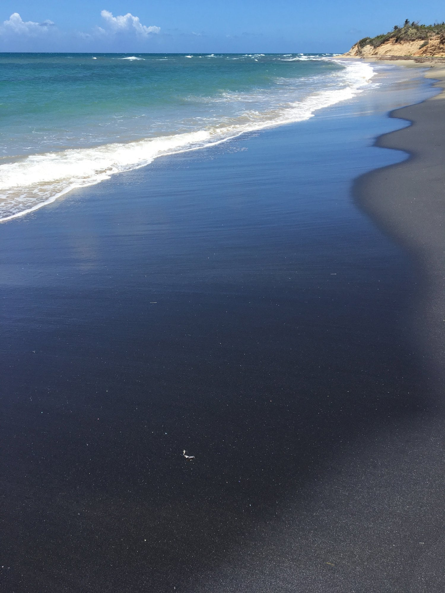Black Sand Beach, blue water