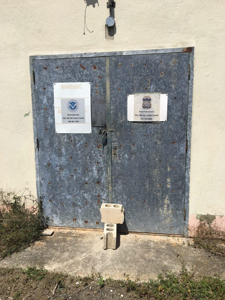 Closed doors with DHS warning signs