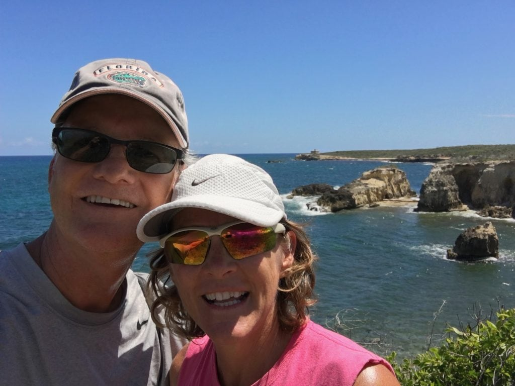Norm and Deb, cliffs in the background