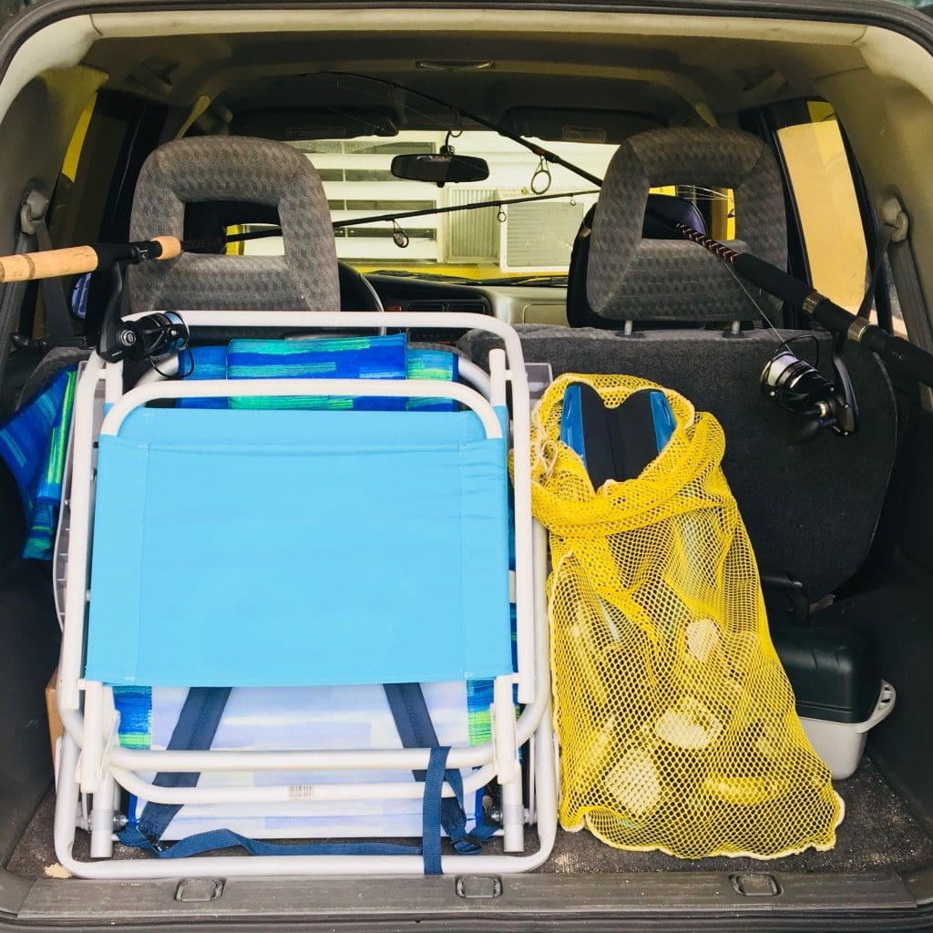 Car full of beach chairs, snorkel gear, fishing gear